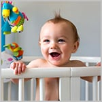 Smiling Baby in Crib