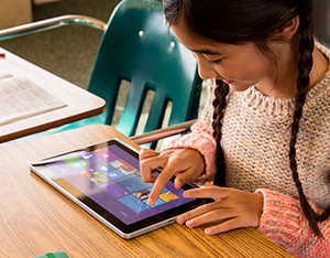 Girl using Microsoft Surface tablet in classroom