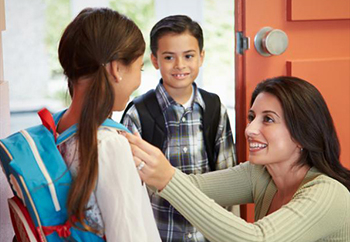 Mom getting kids ready for school